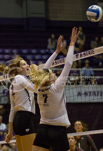 Junior middle blocker Macy Flowers and junior Kylee Zumach scream tip as the ball comes down during the volleyball game against Arkansas in Ahearn Field House on Aug. 31, 2017. (Sabrina Cline   Collegian Media Group)