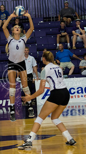 Katie Brand, senior setter, sets the ball for her middle hitter in the match against Mississippi State in Ahern on Sept. 9, 2016. (Sabrina Cline | The Collegian)