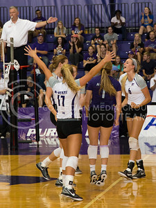 The K-State volleyball team celebrates a point in the game against Mississippi State in Ahearn Field House on Sept. 9, 2016. (Anna Spexarth | The Collegian)
