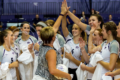 The team celebrates head coach Suzie Fritz's 300th career win as well as the program's 800th win after the match against Mississippi State in Ahern on Sept. 9, 2016. (Sabrina Cline | The Collegian)