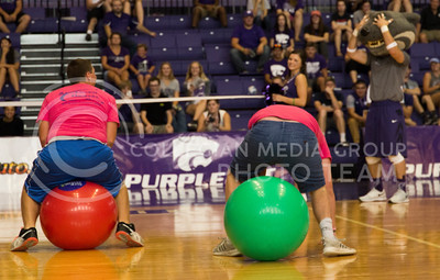 Students race across Ahearn Field House in between sets during the K-State versus Mississippi State volleyball game on Sept. 9, 2016. (Anna Spexarth | The Collegian)