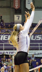 Senior setter Katie Brand blocks the ball in the game against Miami on Sept. 9, 2016, in Ahearn Field House. (Maddie Domnick | The Collegian)