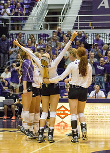 The K-State volleyball team celebrates its defeat of Miami on Sept. 9, 2016, in Ahearn Field House. (Maddie Domnick | The Collegian)