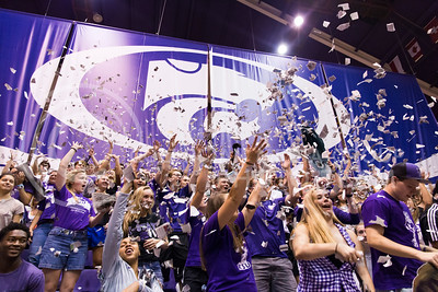 Students cheer and throw newspaper in the air before the beginning of the K-State versus Miami volleyball game on Sept. 9, 2016, in Ahearn Field House. (Anna Spexarth | The Collegian)