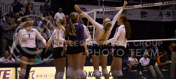 K-State women's volleyball team celebrates a point over Miami during the game in Ahearn Field House on Sept. 9, 2016. (Anna Spexarth | The Collegian)