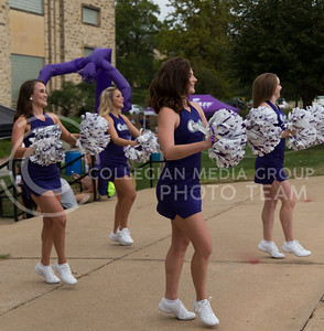 Members of the K-State cheerleading squad perform in front of Ahearn Field House before the K-State versus Miami volleyball game on Sept. 9, 2016. (Anna Spexarth | The Collegian)
