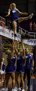 K-State cheerleaders perform aerial moves during the K-State volleyball game against Miami in Ahearn Field House on Sept. 9, 2016. (Nathan Jones | The Collegian)