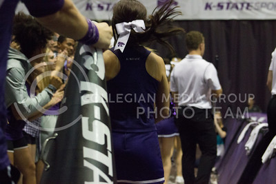 Kansas State's cheer squad pumps up the student section by running through to switch to the other side at the volleyball game against Miami on Sept. 9, 2016, in Ahearn Field House. (Kelly Pham | The Collegian)
