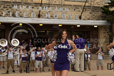 Senior Classy Cat Lauren Dunning performs in front of Ahearn Field House before the K-State versus Miami volleyball game on Sept. 9, 2016. (Anna Spexarth | The Collegian)