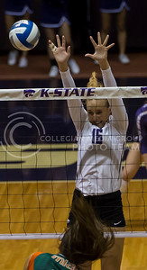Sophomore middle blocker Zsofia Gyimes blocks the ball during the K-State volleyball game against Miami in Ahearn Field House on Sept 9, 2016. (Nathan Jones | The Collegian)