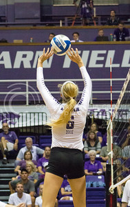 Senior setter Katie Brand sets the ball in the game against Miami on Sept. 9, 2016, in Ahearn Field House. (Maddie Domnick | The Collegian)