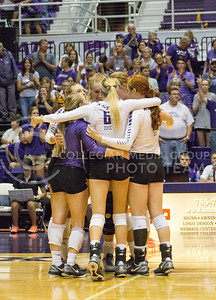 The K-State volleyball team huddles and celebrates its defeat of Miami on Sept. 9, 2016, in Ahearn Field House. (Maddie Domnick | The Collegian)