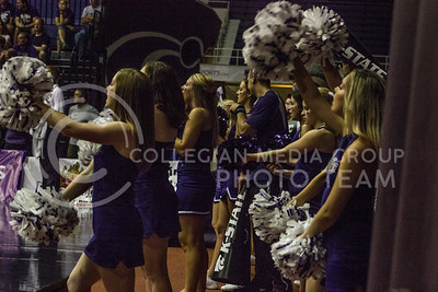 Kansas State's cheer squad pumps up the crowd with cheers and chants at the volleyball game on Sept. 9, 2016, in Ahearn Field House. (Kelly Pham | The Collegian)