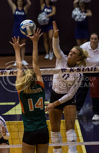 Senior outside hitter Brooke Sassin blocks the ball during the K-State versus Miami volleyball game in Ahearn Field House on Sept. 9, 2016. (Nathan Jones | The Collegian)