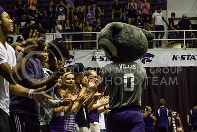 "Willie the Wildcat runs through the student section and pumps up the energy while the band plays the ""Wabash Cannonball"" at Kansas State's volleyball game against Miami on Sept. 9, 2016. (Kelly Pham 