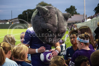 Willie the Wildcat signs autographs for young fans during K-State Women's Soccer. (Nick Horvath | The Collegian)
