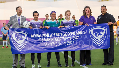Athletics director John Currie, sophomore defender Haley Sutter, junior goalkeeper Miranda Larkin, sophomore midfileder Morgan Mauck, assistant coadh Jessica Smith, and head coach Mike Dibini hold a banner before  the game against University of Northern Iowa on Sept. 16, 2016, in the K-State Soccer Stadium. (Nathan Jones | The Collegian)