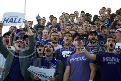 The student section at the women's soccer game yell their chants as kickoff comences at the first ever soccer game in Kansas State University history. (Nick Horvath | The Collegian)