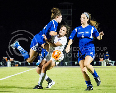 Junior midfielder Jaclyn Means pushes a UMKC player off of her during the last home game on Sept. 30, 2016. The Wildcats scored a 2-0 win over the  Kangaroos in their fourth game of the season. (Alanud Alanazi   The Collegian)