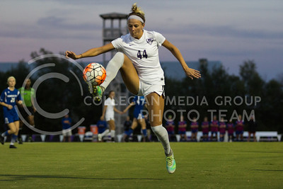 Sophomore forward Tatum Wagner kicks the ball to keep it in bounds during the game against UMKC at the K-State Soccer Complex on Sept. 30, 2016. (Sabrina Cline   The Collegian)