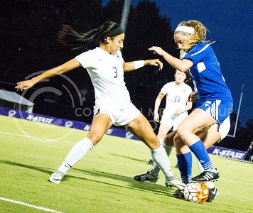 Sophomore defender Haley Sutter reaches for the ball to take it from one of UMKC's players during K-State's fourth home soccer match of the season on Sept. 30, 2016. The Wildcats won 2-0 over the Kangaroos. (Alanud Alanazi   The Collegian)