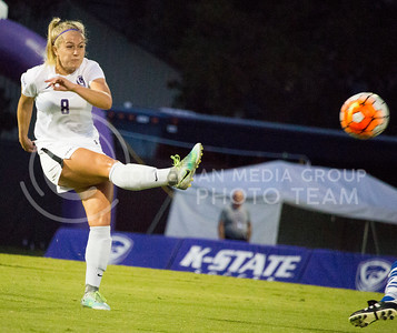 Senior defender Abby Fiser kicks the ball to one of her teammates during the last home game of the season on Sept. 30, 2016, against UMKC. K-State's soccer team won 2-0 over UMKC. (Alanud Alanazi   The Collegian)