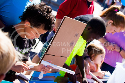 Fair attendees assemble a robot during the Mini Maker Faire in Aggieville on Sept. 10, 2016. (Alanud Alanazi | The Collegian)