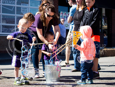 Fair attendees circle around a soap bucket during the Mini Maker Faire held in Aggieville on Sept. 10, 2016. (Alanud Alanazi | The Collegian)