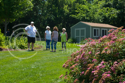Visitors tour the personal gardens of Mark Robb, a Manhattan local, during the 29th Annual Master Garden tour in Manhattan, KS on June 11, 2017. The tour featured six residential gardens as well as the K-State gardens. (Justin Wright | Collegian Media)