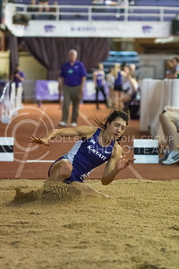 Senior Zanri Van Der Merwe lands in the sand in the long jump event at the K-State track meet in Ahearn Field House on Feb. 17, 2017. (John Benfer | The Collegian)