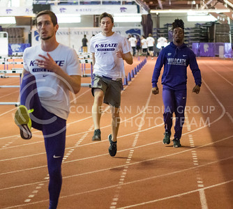 K-State Track and Field athletes warmup for their track meet in Ahearn Field House on Feb. 17, 2017. (John Benfer | The Collegian)