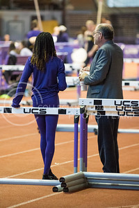 Freshman Akia Guerrier talks with coach Cliff Rovelto at the K-State track meet in Ahearn Field House on Feb. 17, 2017. (John Benfer | The Collegian)