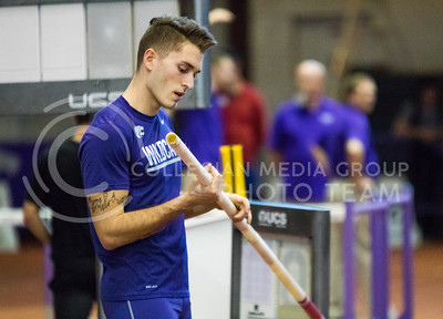 Sophomore Simone Fassina holds a pole vaulting pole at the K-State track meet in Ahearn Field House on Feb. 17, 2017. (John Benfer | The Collegian)
