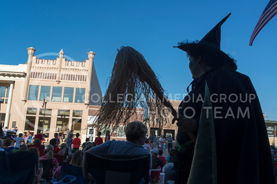 A women dressed as the Wicked Witch from the Wizard of Oz walks around Downtown Wamego during the annual parade on July 4, 2016. (Evert Nelson | The Collegian)