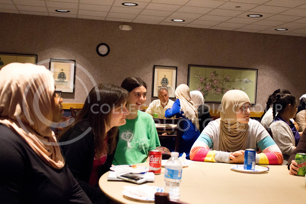 "Event attendees socialize over food and listen to other women talk about their day with the hijab during the ""A Day in A Hijab"" debriefing in the student union on April. 19. (Alanud Alanazi 