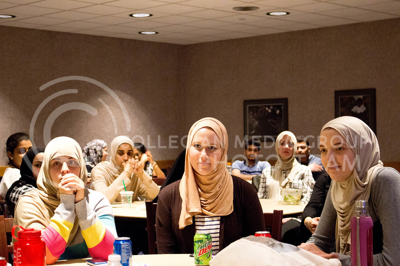 "Event attendees listen to women's discussions and comments they received while wearing the hijab during the ""A Day in A Hijab"" debriefing in the student union on April. 19. (Alanud Alanazi 