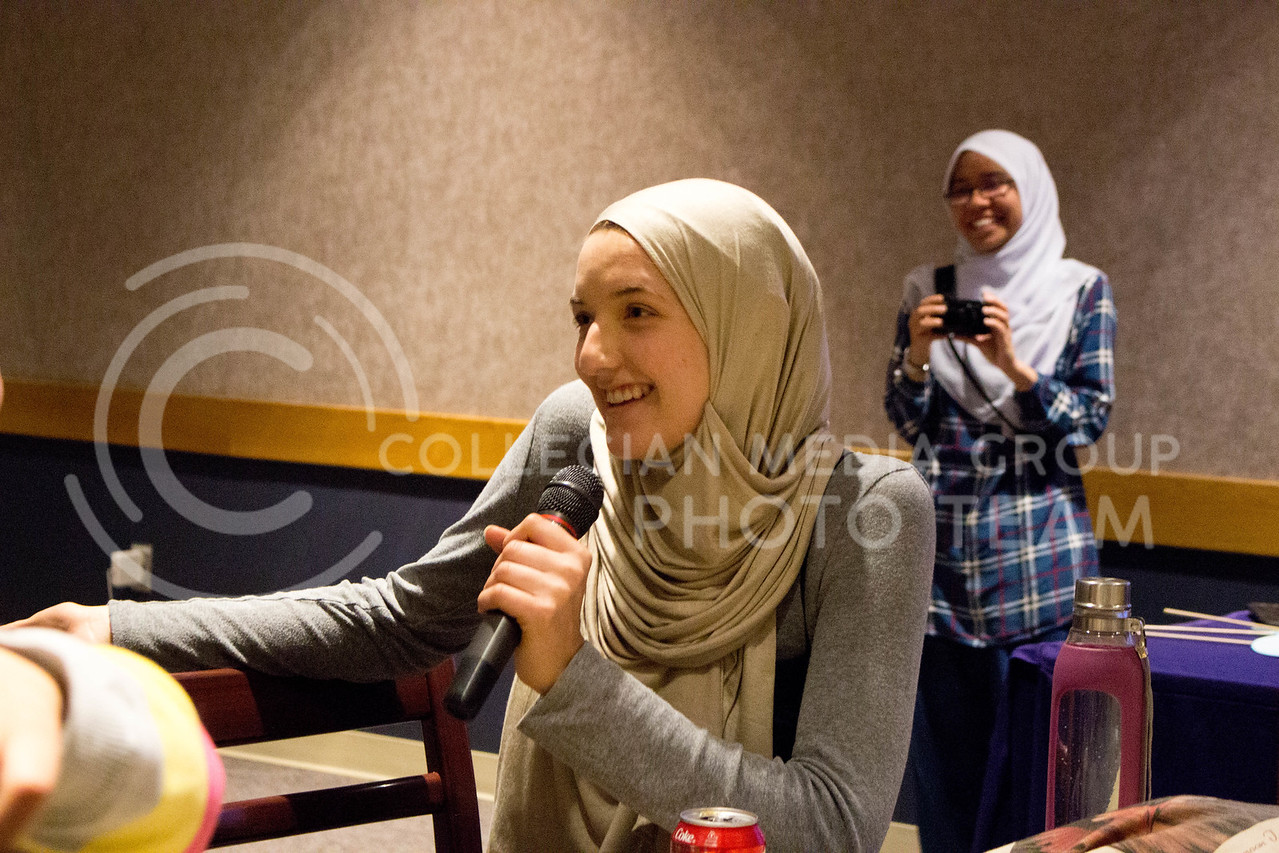 "Event attendees shares an anecdote about her day wearing the hijab during the ""A Day in A Hijab"" debriefing in the student union on April. 19. (Alanud Alanazi 
