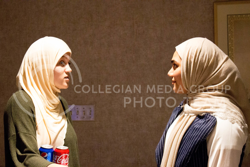 "Event attendees socialize over food and talk about their day with the hijab during the ""A Day in A Hijab"" debriefing in the student union on April. 19. (Alanud Alanazi 