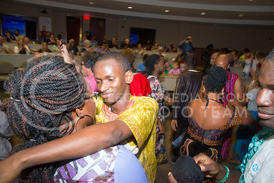 The Mandela Washington Fellows dance and embrace as they display a traditional African wedding during Africulture in the Town Hall room of the Leadership Studies Building on July 16, 2016. (Evert Nelson | The Collegian)
