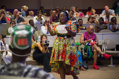 Stu Wambulawae, from Zambia, recites a poem in front of the audience gathered in the Town Hall room in Leadership Studies Building on July 16, 2016. Wambulawae is one of 24 Mandela Washington Fellows who presented during the Africulture event. (Evert Nelson | The Collegian)