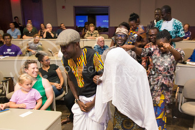 A women in a gown is walked down the aisel in the Town Hall room of the Leadership Studies Building on July 16, 2016 to illustrate a traditional African wedding during Africulture. The event featured the 24 Mandela Washington Fellows who visited campus and shared their culture. (Evert Nelson | The Collegian)