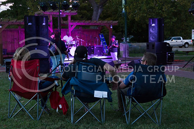 People listen to Madam Groove perform in Triangle Park during Aggiefest on Oct. 16, 2016. (Anna Spexarth   The Collegian)