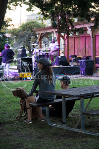 People listen to Madam Groove perform in Triangle Park during Aggiefest on Oct. 16, 2016. (Anna Spexarth | The Collegian)