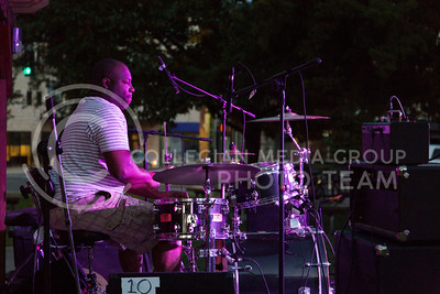 The drummer of Madam Groove performs in Triangle Park during Aggiefest on Oct. 16, 2016. (Anna Spexarth   The Collegian)