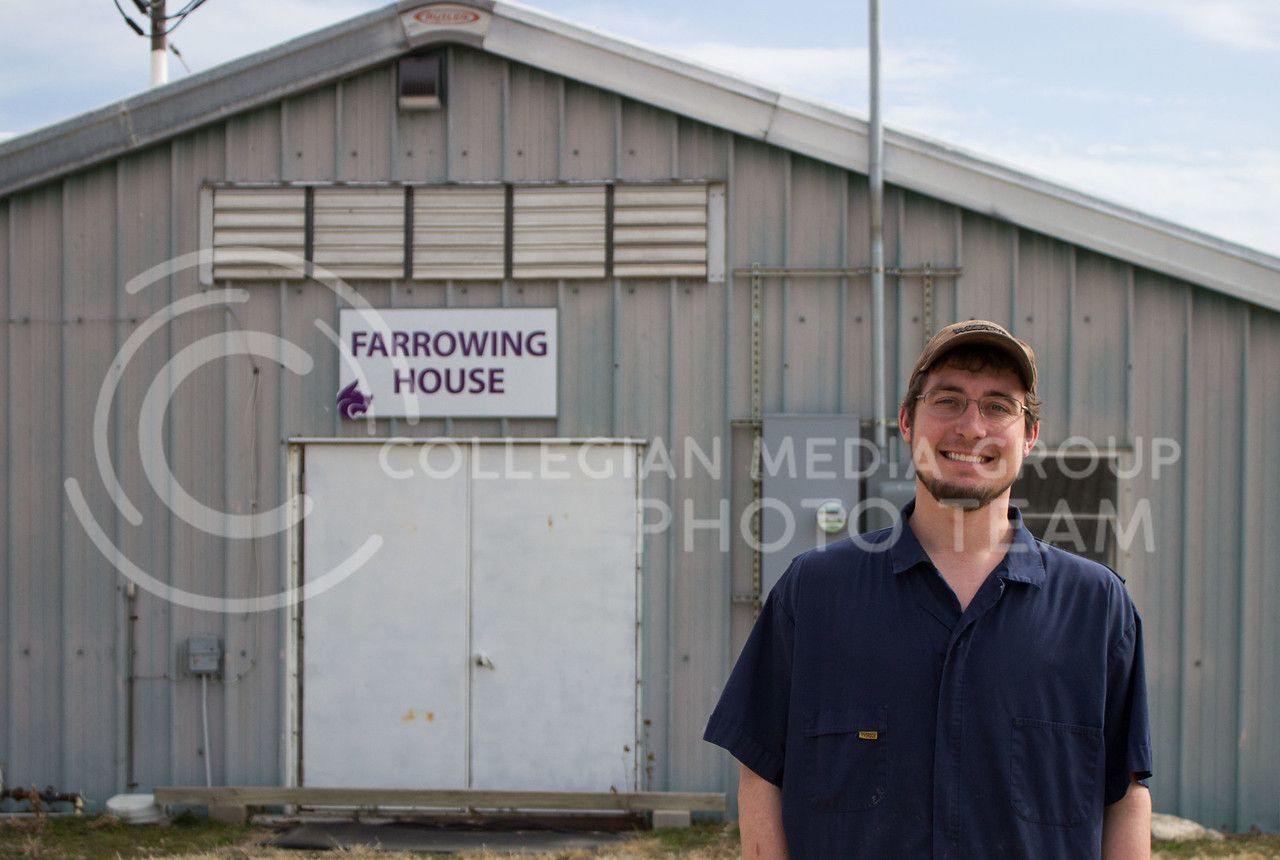 Dylan Goeckel, senior in agribusiness, stands in front of the farrowing house at K-State's swine teaching and research center on Feb. 27, 2017. Dylan is one of the many K-State students who works with the animals regularly. (Regan Tokos | The Collegian)