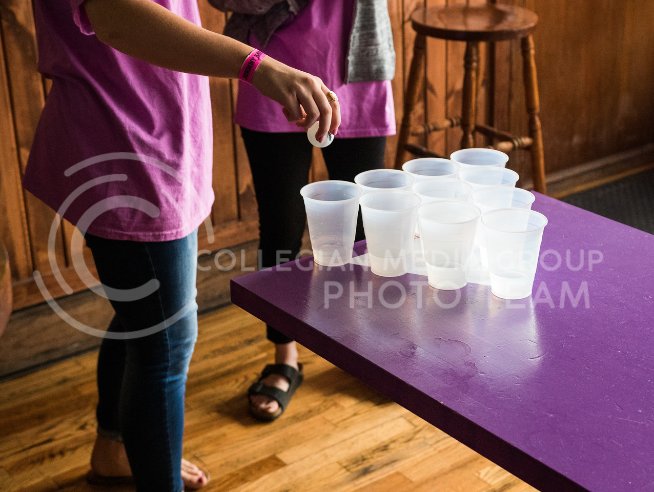 Attendees play water pong at the Ayres Baalman Rally in Johnny Kaw's Sports Bar on Feb. 11, 2017. (John Benfer   The Collegian)