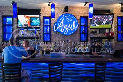 Patrons enjoy drinks at the bar of Azul Mexican Bar and Grill in Aggieville on July 19, 2016. The new restaurant features tables and bars inside and a rooftop section. (Evert Nelson | The Collegian)