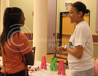 Taj Brimmer (right), senior in PR, talks to Jasmine Gray  (left), about Alpha Kappa Alpha sorority at the BSU back to school BBQ in the Student Union Ballroom on August 27, 2016. (Miranda Snyder | The Collegian)