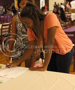 Jasmine Gray, freshman in business, signs up to receive more information at the Alpha Kappa Alpha sorority table at the BSU back to school BBQ in the Student Union Ballroom on August 27, 2016. (Miranda Snyder | The Collegian)