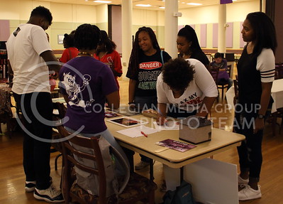 Student sign up to receive more information on the Ebony Theatre at the BSU back to school BBQ in the Student Union Ballroom on August 27, 2016. (Miranda Snyder | The Collegian)